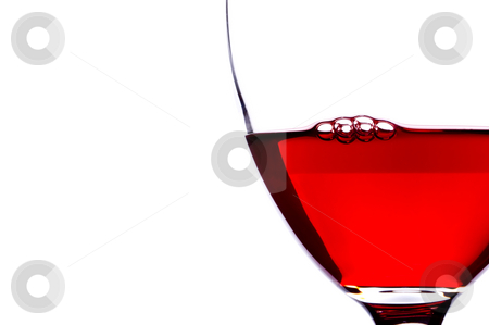 Extreme close-up of bubbles in red wine stock photo, Extreme close-up of bubbles in a glass of red wine by Vince Clements