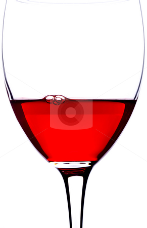 Closeup Glass of red wine stock photo, A closeup of a glass of red wine with bubbles by Vince Clements