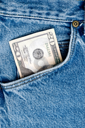 Money in blue jeans pocket stock photo, A closeup of money in blue jeans pocket by Vince Clements