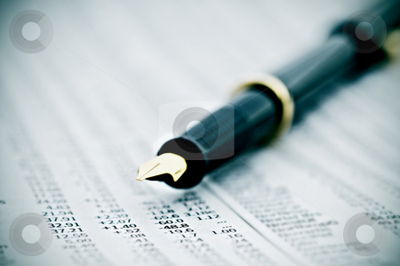 Macro of a fountain pen stock photo, Macro of a fountain pen on a newspaper stock report by Vince Clements