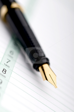 Macro of a fountain pen on a day planner stock photo, Macro of a fountain pen on a business day planner by Vince Clements