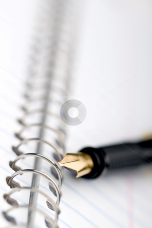 Shallow focus macro of a fountain pen stock photo, Shallow focus macro of a fountain pen on a spiral bound notebook by Vince Clements