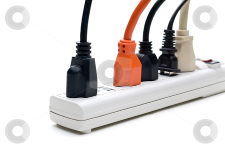 Plugs in a power strip stock photo, Plugs in a power strip by Vince Clements