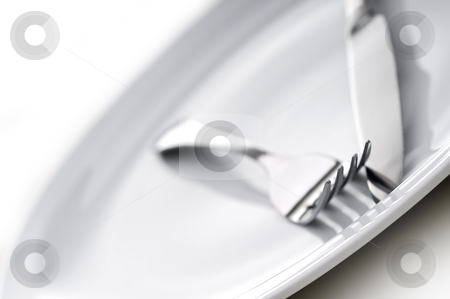 Shallow focus silverware on a plate stock photo, Shallow focus silverware on a plate by Vince Clements