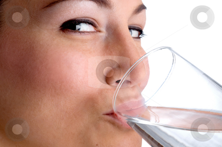 Attractive young woman drinking water stock photo, Attractive young woman drinking water by Vince Clements
