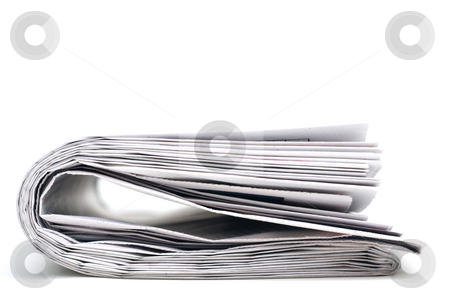 Closeup of a newspaper stock photo, Closeup of a folder newpaper on white by Vince Clements