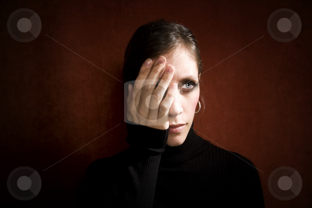 Pretty Woman with hand over her face stock photo, Pretty Woman a Black Turtleneck Covering her Eye by Scott Griessel