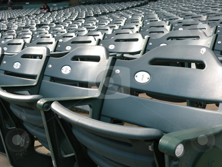 Empty stadium seats stock photo, Sport stadium seats left empty during an event by Rob Wright