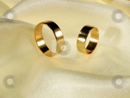 Wedding ring stock photo, Wedding ring on silk by Marek Kosmal