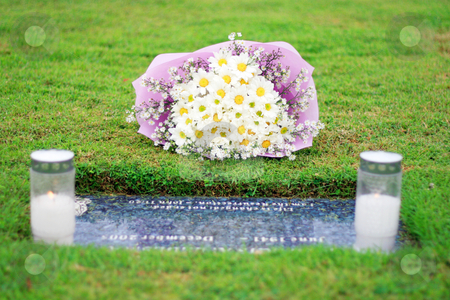 Eternal garden stock photo, Eternal garden cemetery with flowers and candles beside a tombstone by Jonas Marcos San Luis
