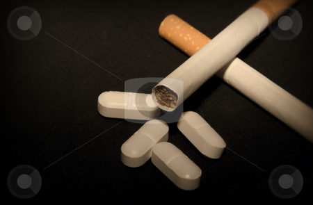 Cigarettes and pills stock photo, Cigarettes and pills by John Teeter
