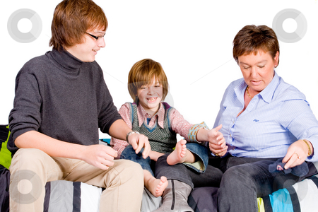 Young boy's tickling stock photo, Young happy child is getting tickled by his family by Frenk and Danielle Kaufmann