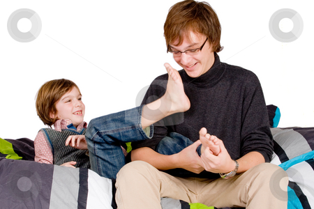 Older brother is tickling the young one stock photo, Young happy child is getting tickled by his family by Frenk and Danielle Kaufmann
