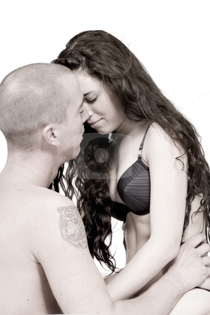 Young couple who are in love facing each other stock photo, Girlfriend and boyfriend being passionate with each other by Frenk and Danielle Kaufmann