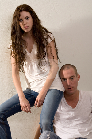 Young couple who are in love she is sitting on his shoulder stock photo, Girlfriend and boyfriend being passionate with each other by Frenk and Danielle Kaufmann