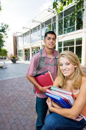 Two Students at School - Vertical stock photo, Two students by Orange Line Media