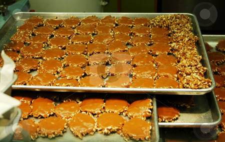 Pralines on a baking sheet stock photo, Pralines on a baking sheet ready to be packaged by Tim Markley