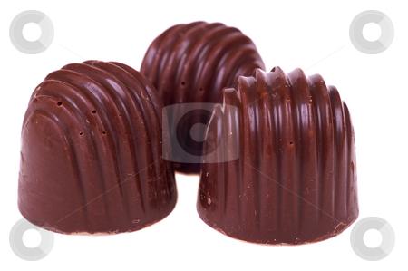 Sweet food stock photo, Three chocolates candy isolated on white background by Marek Kosmal