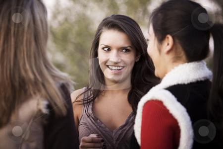 Three Friends stock photo, Portrait of three female friends focusing on Hispanic woman by Scott Griessel