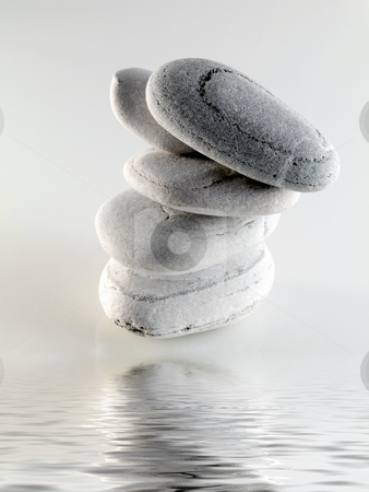 Baech stones with water stock photo, White off beach stones with water reflection by Laurent Dambies