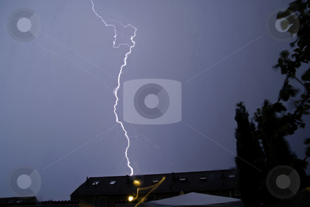 Thunderstorm in the Netherlands stock photo, A thunderstorm advances above house roofs in the Netherlands by Gert-Jan Kappert