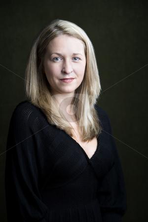 Pretty Blonde Woman stock photo, Portrait of pretty blonde woman on a dark background by Scott Griessel