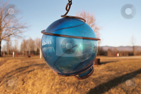 Blue ball stock photo, A hanging decorative blue ball by Tim Markley