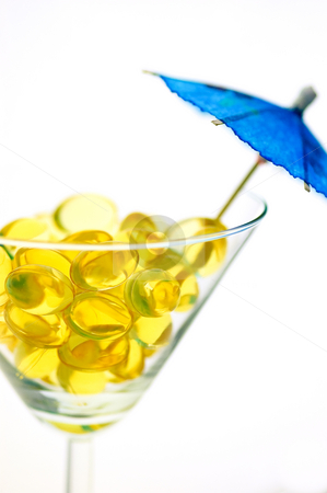 Margarita glass  stock photo, Concept of omega-3 pills taken as a tropical drink by Rubens Alarcon