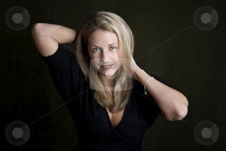 Pretty woman with blue eyes stock photo, Pretty woman with blue eyes and hands behind her head by Scott Griessel