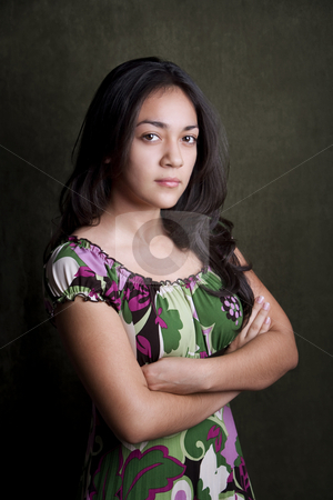 Sterh Hispanic Girl stock photo, Hispanic girl with arms folded and stern expression by Scott Griessel