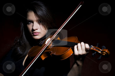 Hispanic woman playing violin stock photo, Pretty Hispanic woman in studio playing a violin by Scott Griessel