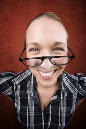 Pretty nerd woman in reading glasses stock photo, Pretty nerd woman in plaid bluse and glasses by Scott Griessel