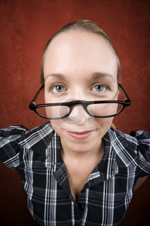 Pretty nerd woman in reading glasses stock photo, Pretty nerd woman in plaid bluse and glasses by Scott Griessel