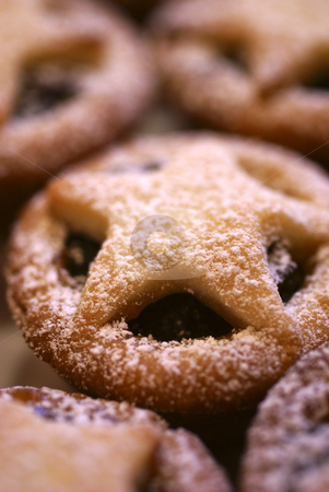 Freshly Dusted stock photo, A macro shot of a plate of mince pies, with a central mince pie covered in a pastry star and freshly dusted with icing sugar by Tim Green