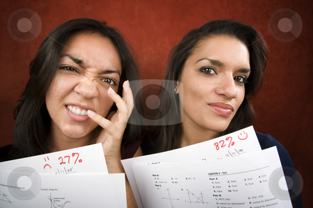 Girls with Math Scores stock photo, Two girls with conrasting scores on school tests by Scott Griessel