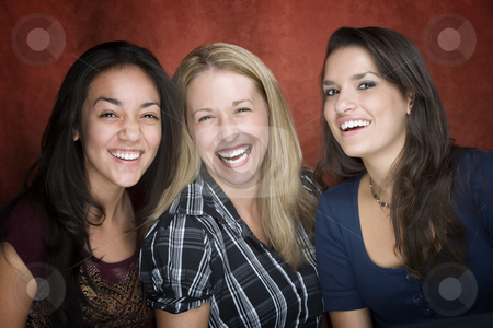 Three Laughing Women stock photo, Three pretty women laughing in a studio setting by Scott Griessel