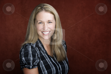 Smiling Blonde Woman stock photo, Smiling blonde woman in a studio setting by Scott Griessel
