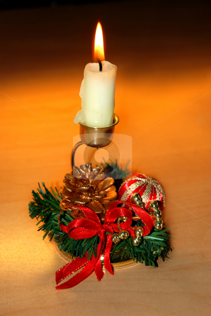 Christmas candle stock photo, Christmas burning candle over orange in decorative candlestick by Julija Sapic