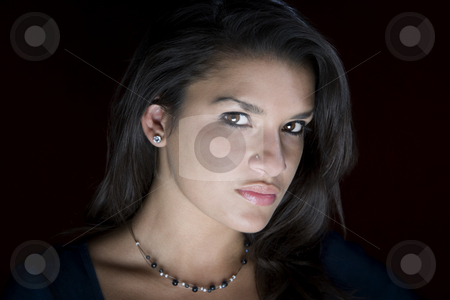 Pretty Young Hispanic Woman stock photo, Pretty young Hispanic woman in a studio by Scott Griessel
