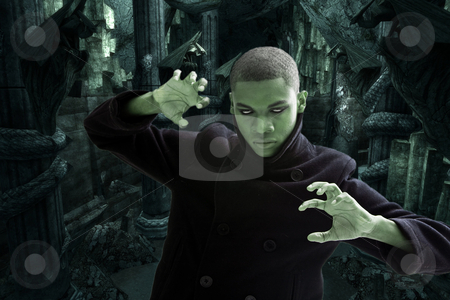 Scary man in dungeon stock photo, Green man with smokey white eyes, strong expression and black coat in dungeon hall way, isolated by Paul Hakimata