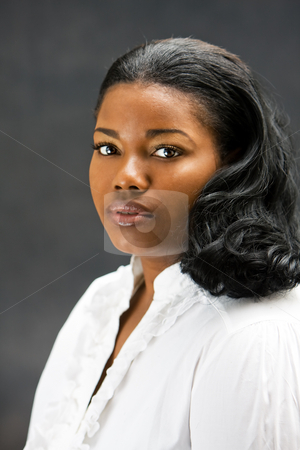 Beautiful African woman stock photo, Portrait of a beautiful African-America woman in white shirt, isolated by Paul Hakimata