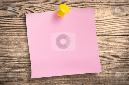Pink paper note  on wood, clipping path. stock photo, Pink paper note with thumbtack on wooden surface, clipping path. by Pablo Caridad