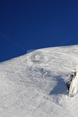 Windblown Mountain Top stock photo, Sparkling snow covered mountain peak on a clear cloudless day, image contains GPS location information by Lynn Bendickson