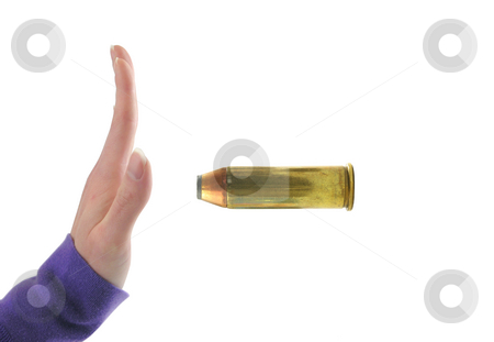 Hand stopping bullet stock photo, Hand stopping a bullet on white background by John Teeter