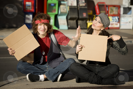 Young Man and Woman with Blank Cardboard Signs stock photo, Attractive Young Man and Woman with Blank Cardboard Signs by Scott Griessel