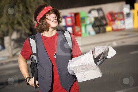 Young Tourist with Map stock photo, Handsome Young Male Tourist with Crumpled Map by Scott Griessel
