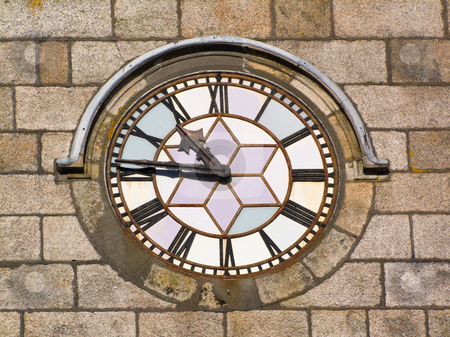 Close up of an old clock face on a stone wall. stock photo, Close up of an old clock face on a stone wall. by Stephen Rees