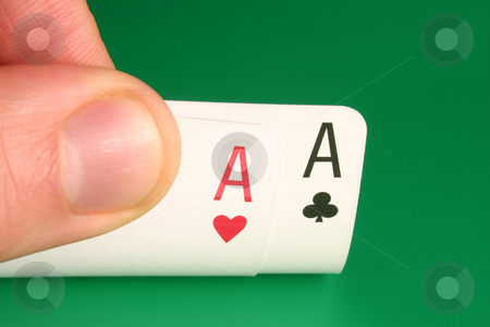 Looking at pocket aces during a poker game. stock photo, Looking at pocket aces during a poker game. by Stephen Rees