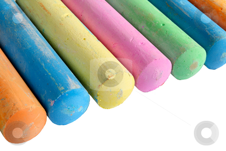 A line of colorful large chalk sticks on a white background. stock photo, A line of colorful large chalk sticks on a white background. by Stephen Rees
