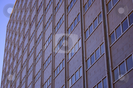 Apartment View stock photo, Architecture, Low view point of High-rise, High-rise windows, Sky scrapers, Diagonal view of Sky scraper windows, Sky scraper blue background by Richard Clack